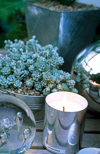 Silver candle holder and glass paperweight - © GAP Photos