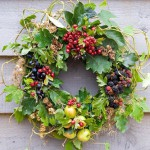 Autumn wreath made from foraged natural materials - wild berries and foliage inc Malus sylvestris - Crabapples, Crataegus monogyna - Hawthorn, Rubus fruticosus - Blackberries and Prunus spinosa - Sloes or Blackthorns