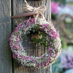 Heather wreath on wooden gate - Calluna vulgaris 'Madonna', Calluna vulgaris 'Pink Madonna', Calluna vulgaris 'Gina'