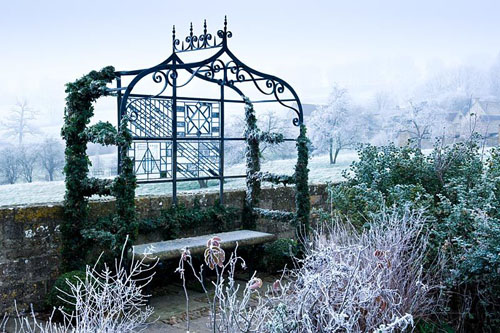 Ornate arbour - Bourton House Garden, Bourton-on-the-Hill, Moreton-in-Marsh, Gloucestershire - © Jason Ingram/GAP Photos