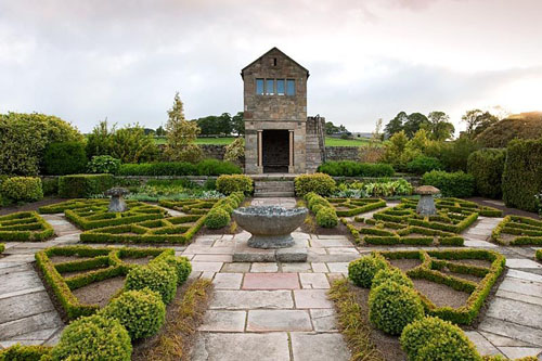 The Fancy Garden includes a gazebo, from which to gaze upon the garden, and a pattern made from box based on a Tudor rose pattern - Herterton House, Hartington, Northumberland, UK - © Carole Drake/GAP Photos