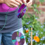Step-by-step - Creating string of CD's to keep birds away from vegetable beds