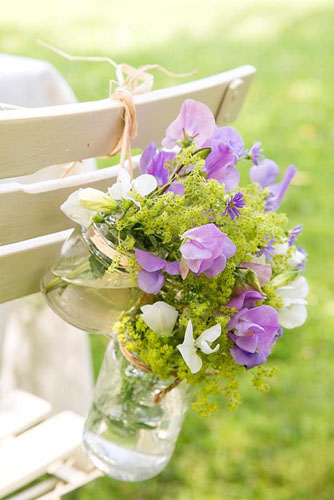 Sweet pea and Alchemilla mollis wedding chair decoration.