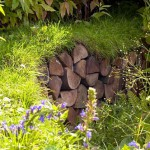 Wildlife garden - Nature's Way at Tatton Park Flower Show. Pile of logs with turf