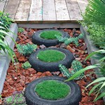 Reclaimed Car tyres used as 'stepping stones' planted with turf