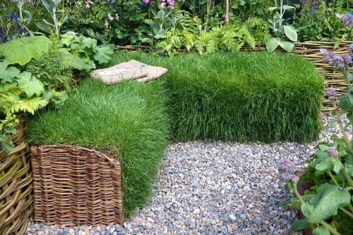 Wicker sided turf seat surrounded by raised bed and flowering perennial plants. Limerick Culture Garden. Large Garden Silver Medal Winner by Ailish Drake at Bloom Garden Festival Ireland 2014.