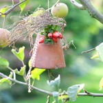 Decorative chuck bell hanging from apple tree
