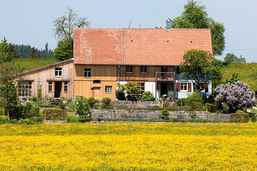 German country house with a shed and both traditional and modern elements
