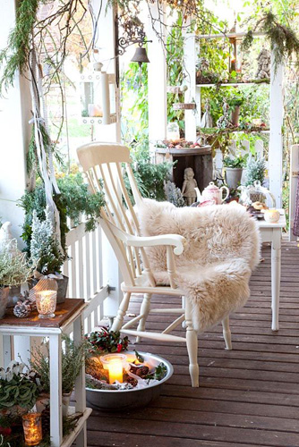 Terrace with chair, candles, various plants in pots and ornaments - © Elke Borkowski/GAP Photos