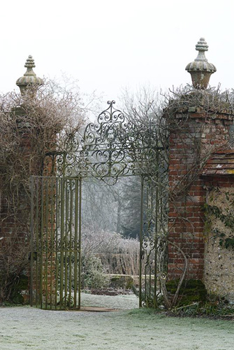 Ornate metal gates in frost, Heale House Gardens, Wiltshire - © Jo Whitworth/GAP Photos