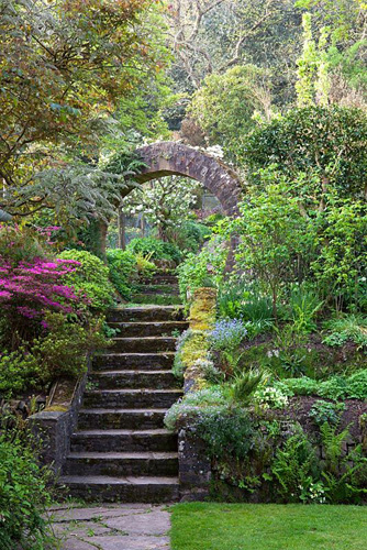 Steps and circular stone arch leading from the main garden to the vegetable garden at Greencombe Gardens, Somerset - © Jonathan Buckley/GAP Photos