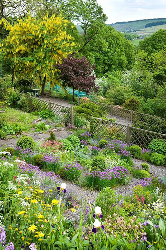 The south facing sloping aspect of cherry hill garden garden has open and long reaching views of the surrounding Derbyshire countryside - © Lee Avison/GAP Photos