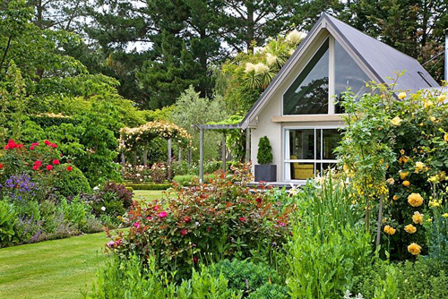 View of house from flowerbed - Breedenbroek, New Zealand - © Steven Wooster/GAP Photos