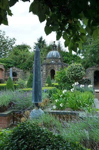 Formal walled courtyard with flint folly and raised beds - © Marcus Harpur/GAP Photos