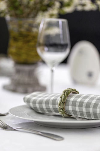 Table setting with napkin rings decorated with catkins