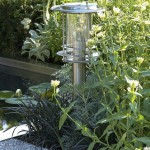 Metal garden lamp at pool edge