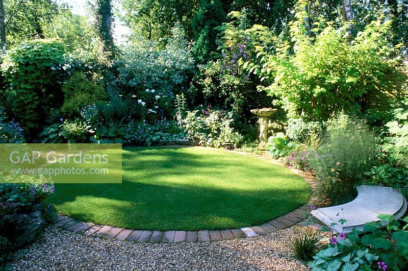Gap gardens shady garden with circular lawn mixed for Circular lawn garden designs