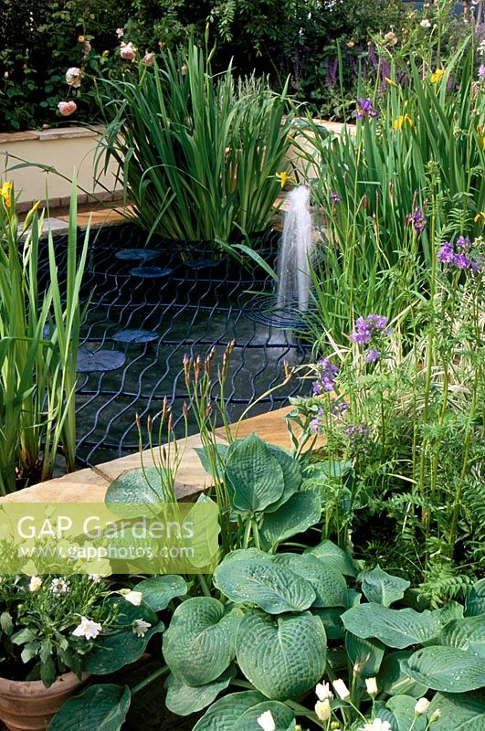 Gap gardens pond with fountain and decorative metal for Garden pond grills
