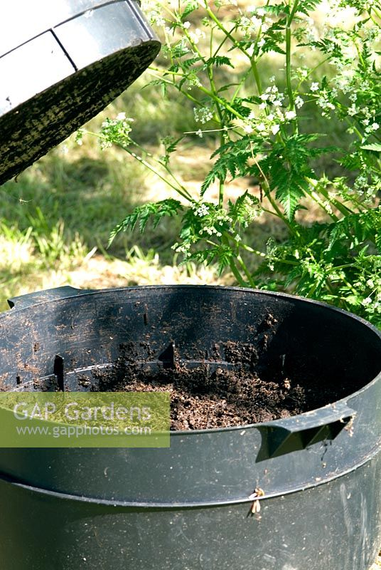 Wormery (Worm Tower or Can-o-worms) used to turn garden and kitchen waste into garden compost by the action of worms. Bottom level tray - fully worked compost ready to harvest. Once harvested this tray becomes the new top level tray.