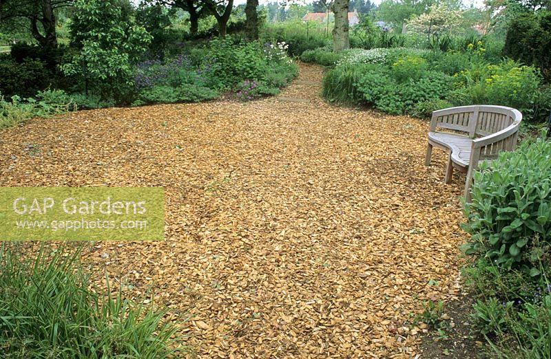 Wood Chip Gardening ~ Gap gardens circular wood chip bark path with seating