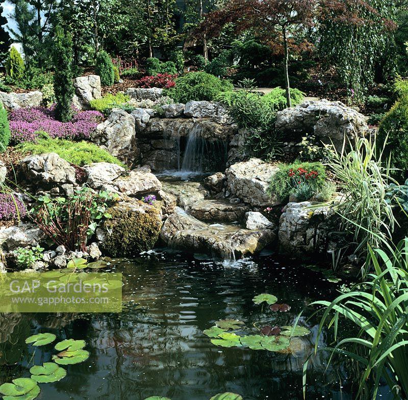 Rock Garden Waterfall Running Into Small Pond