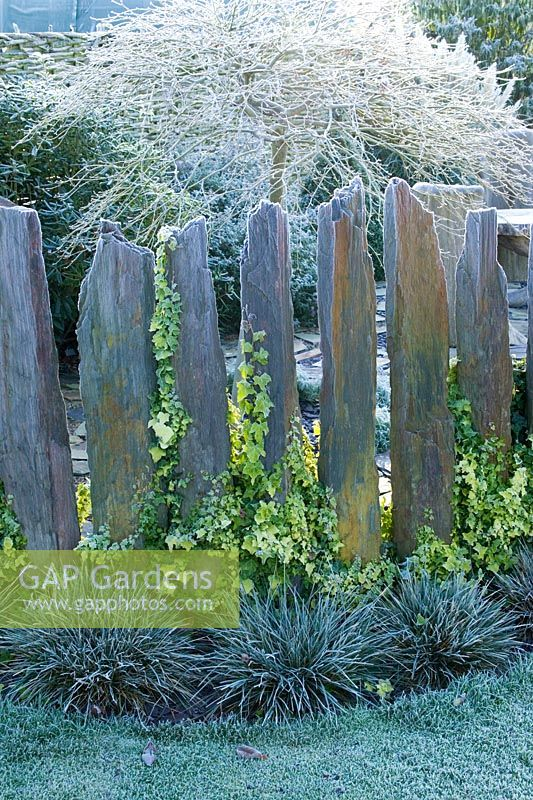 Hoar frost on Indian slate pillars used as low fence.