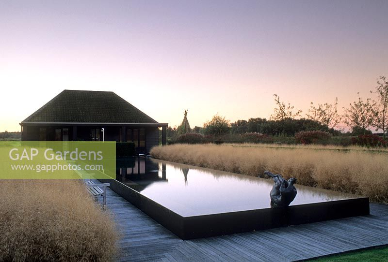 Delightful Contemporary Garden Building With Large Raised Water Feature Edged By  Decking Walkway
