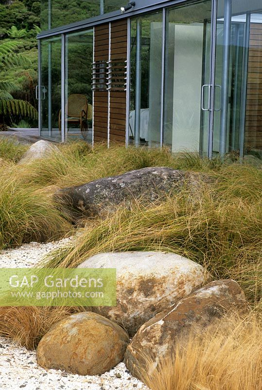 Gap gardens garden view with boulders and native grasses for Native garden designs nz