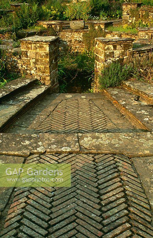 Herringbone Brick Paving Steps Dipping Pool In Courtyard Of Typical Lutyens And Jekyll Style