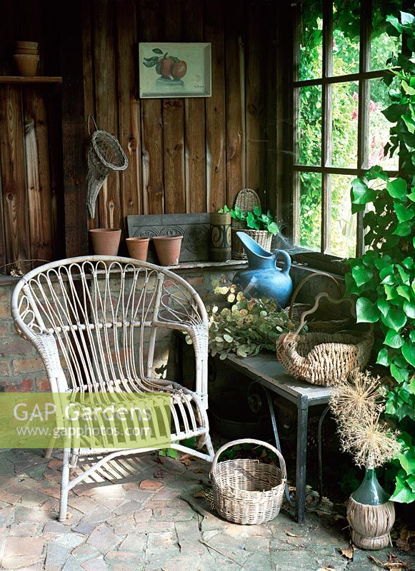 Wicker chair inside old Summerhouse