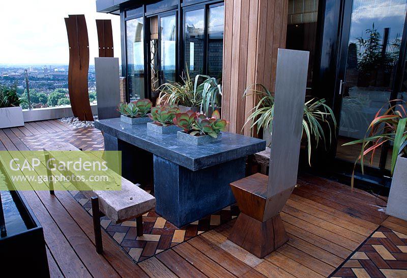 African Themed Roof Terrace With Iroko Decking, Herringbone Brick Design  Panels, Zinc Wrapped