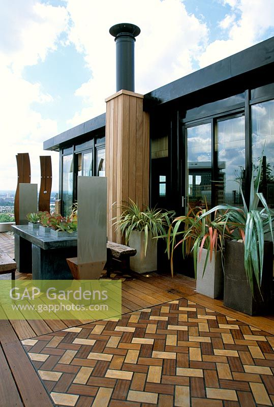 African Themed Roof Terrace With Iroko Decking With Inset Herringbone  Design Panels In Coloured Wood,