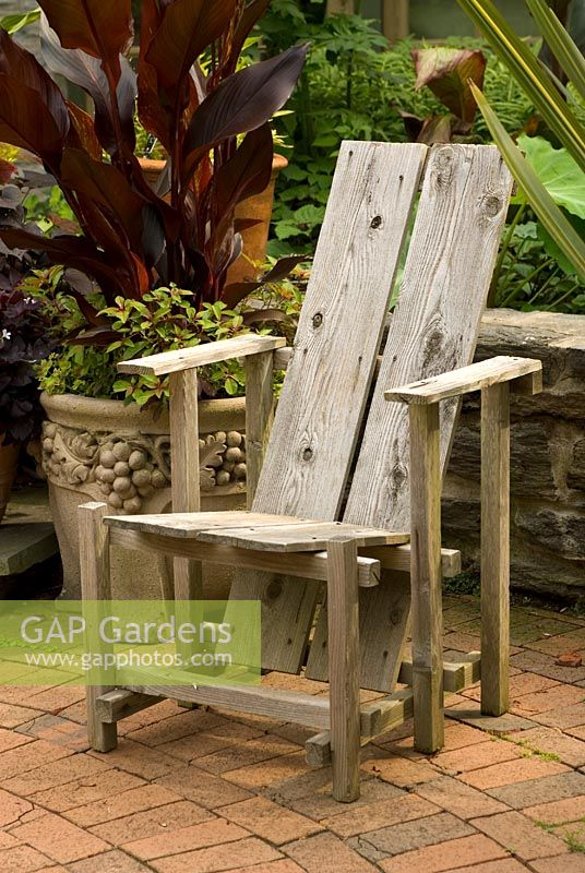 Gap Gardens Wooden Chair On Patio With Exotic Plants In