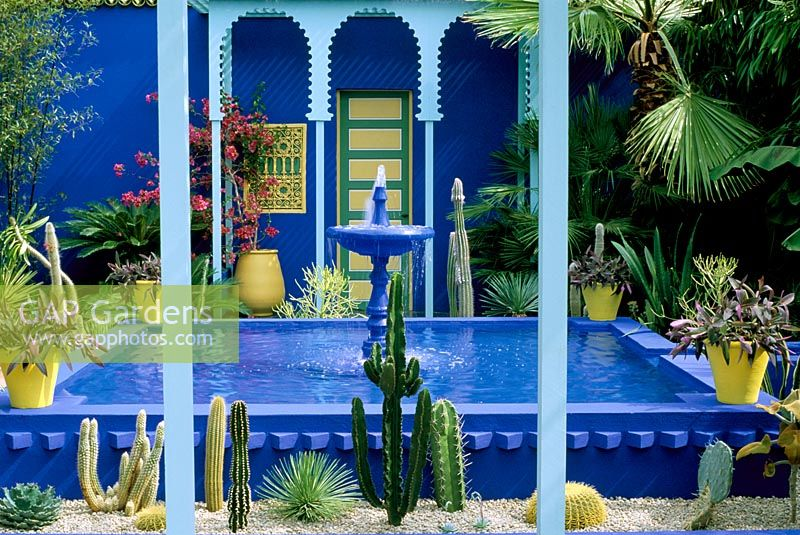 Cobalt Blue Fountain, Cacti And Yellow Terracotta Pots In The Moroccan  Style Yves St.