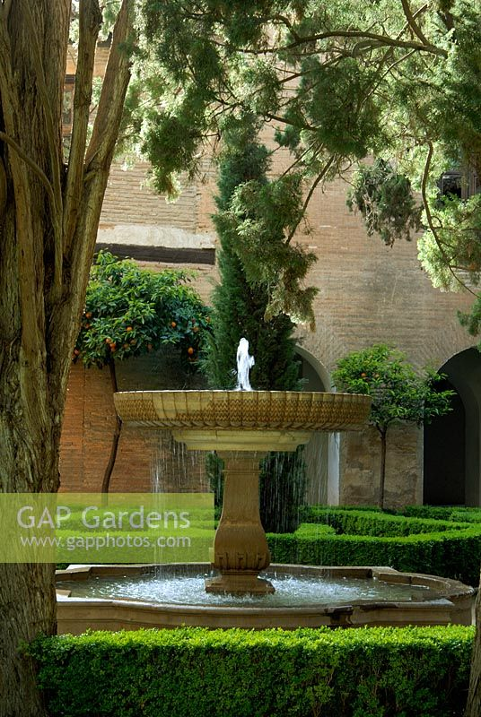 Fountain in a courtyard - Gardens of the Alhambra, Granada, Spain
