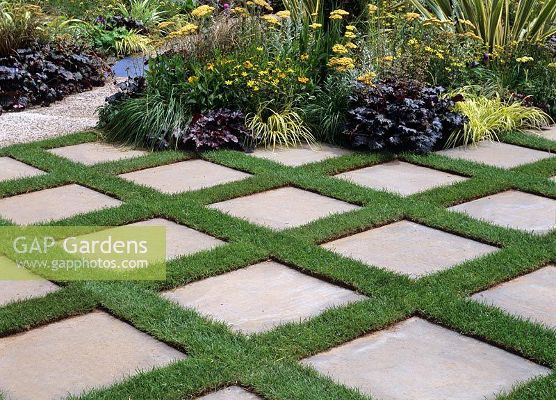 Gap Gardens Repeating Blocks Of Slabs Laid In Grass