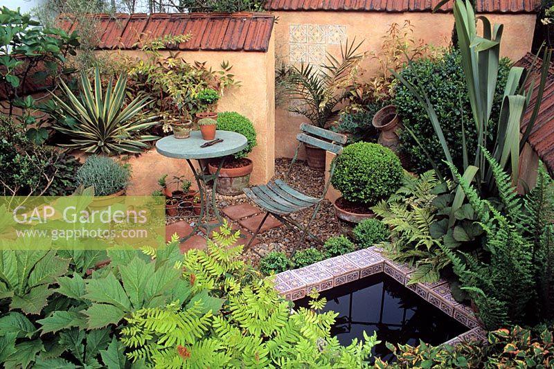Mediterranean Style Courtyard Garden With: Mediterranean Style Courtyard Garden With