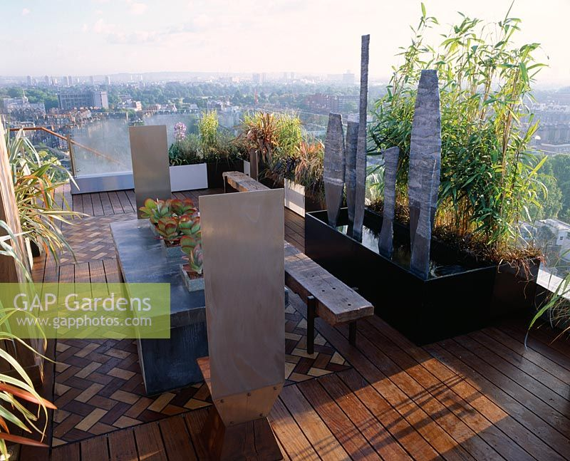 African Themed Roof Terrace With Iroko Decking, Zinc Wrapped Table With  Kalanchoe Thyrsiflora, Stainless