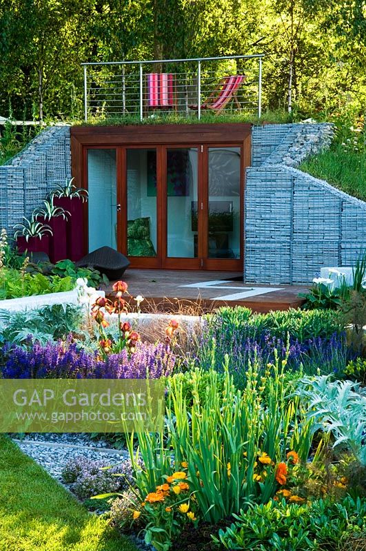 Gap gardens garden office built into wall of gabions Garden office kent