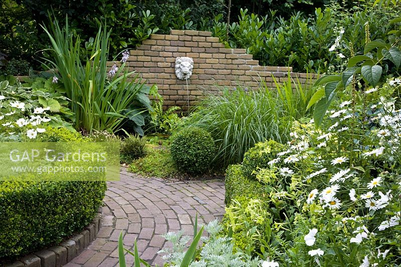 Gap Gardens Brick Path Leading To Wall Mounted Lion 39 S