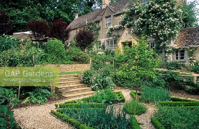 Gravel Paths, Steps And Raised Beds In Herb Garden In Front Of House    Hinton