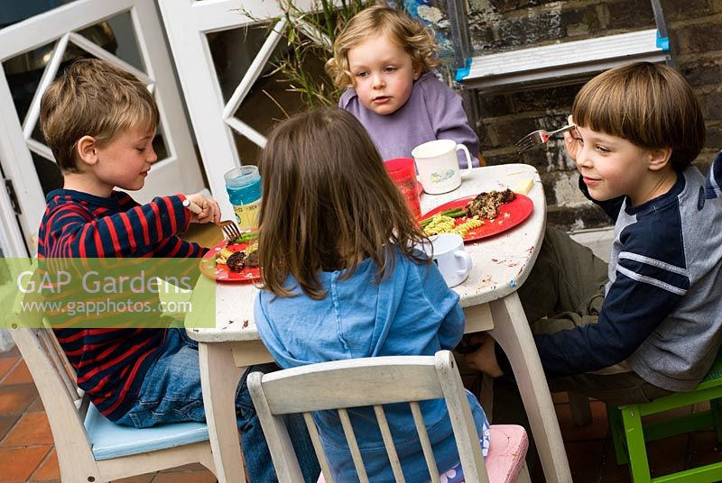 Gap Gardens Children Eating Outside At A Barbecue