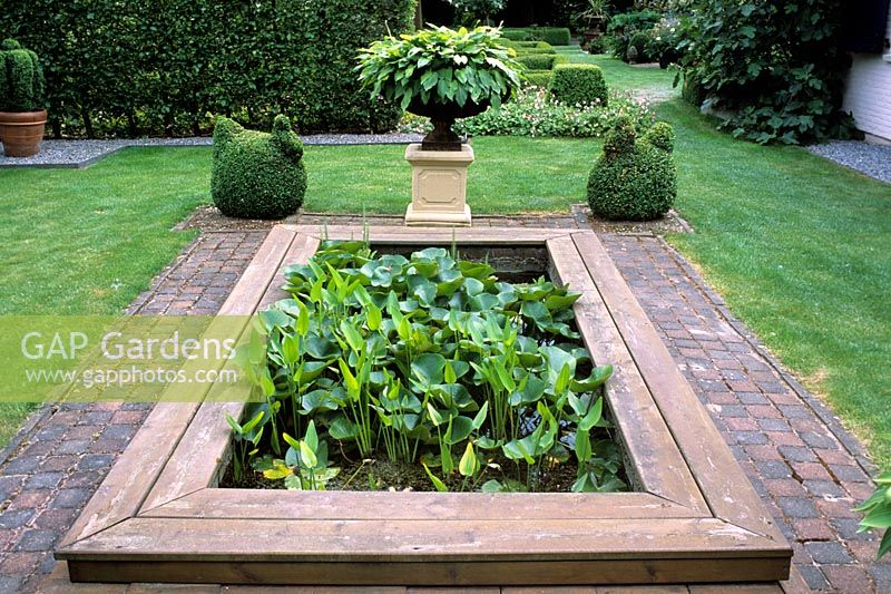Nice Rectangular Pond In Formal Garden With Topiary