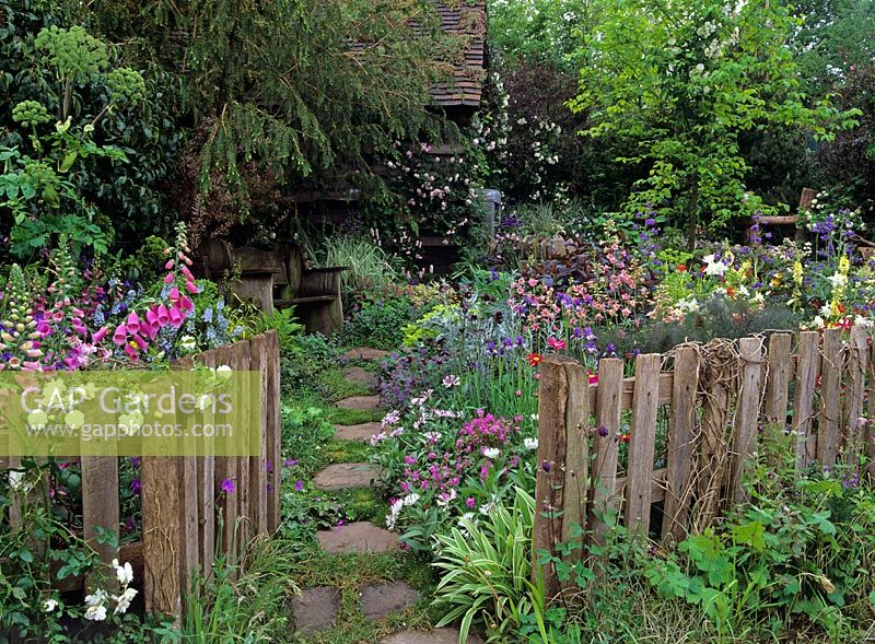 Great Rustic Fence Enclosing A Semi Wild Garden With A Blend Of Natural And Garden  Plants