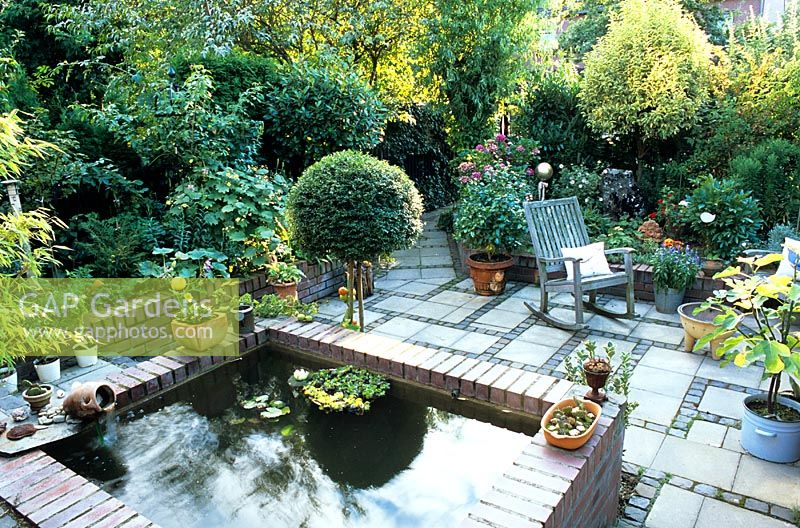Gap Gardens Small Garden With Raised Pond And Rocking