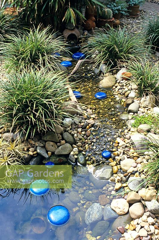 Outdoor Blue Pebbles : Gap gardens small garden stream with painted metallic