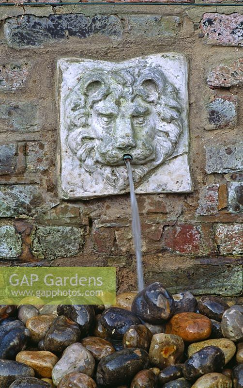 GAP Gardens - Wall mounted lion\'s head water spout above stone ...