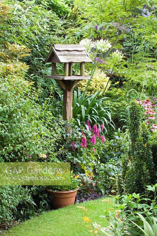 gap gardens bird table in small town garden with good. Black Bedroom Furniture Sets. Home Design Ideas