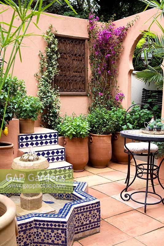 Delightful Moroccan Courtyard With Bouganinvillea, Terracotta Pots With Cyperus  Papyrus And Various Types Of Mint.