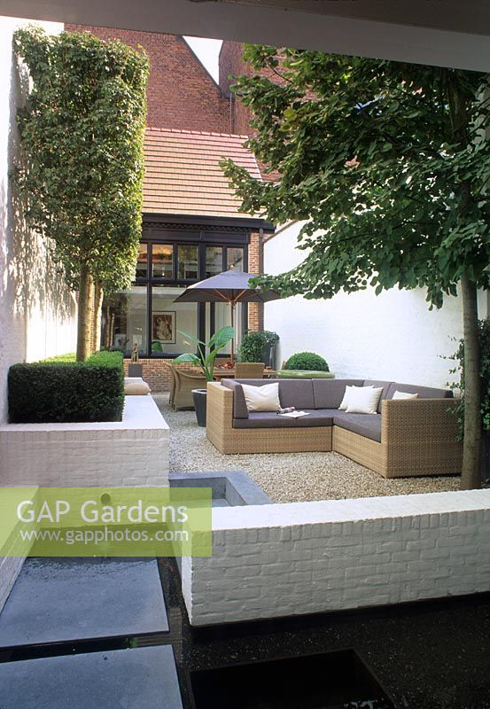 Gap Gardens Small Courtyard Garden With White Painted